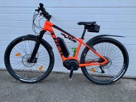 flagship trek e-bike orange for hire