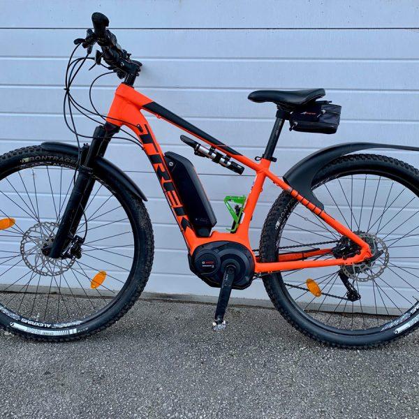 flagship trek e-bike orange for hire